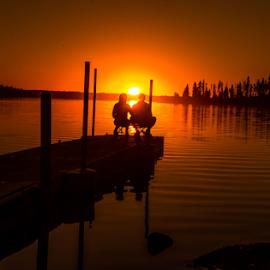 Romantic Sunset by Joseph Law - Landscapes Sunsets & Sunrises ( national park, bushes, beautiful sunset, reflections, trees, elk island, couple, bridge, islland, beautiful evening, enjoy sunset )