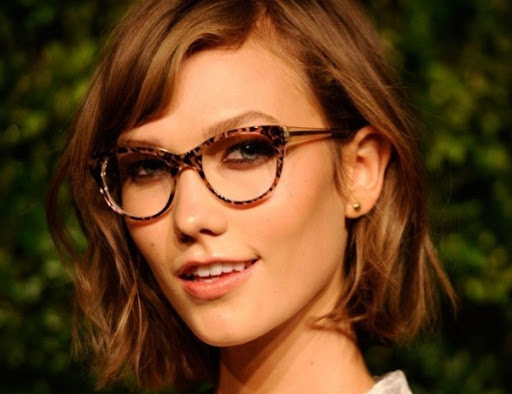 Karlie Kloss wearing caty-eye glasses