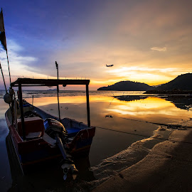 Reflective sunset by Thian Chang Tan - Landscapes Sunsets & Sunrises ( reflection, airplane, sunset, beach, boat,  )