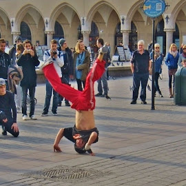 UP SIDE DOWN by Wojtylak Maria - People Musicians & Entertainers ( show, town, square, people, dancer, poland )