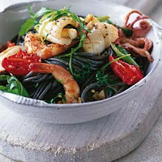 Garlic Squid And Prawns With Black Linguine