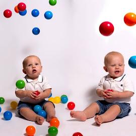 I love balls by Rick Hackley - Babies & Children Babies ( balls, color, baby, boy, portrait )