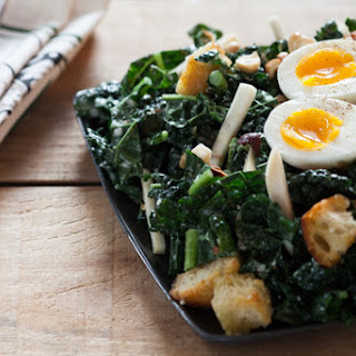 Kale Caesar Salad with Soft Boiled Egg, Toasted Hazelnuts & Homemade Croutons