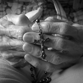 Hand of elder woman holding rosary while praying by Robert Machado - Digital Art People ( blessed, person, old, purity, people, aged, religion, love, spiritual, woman, pray, belief, church, symbol, ritual, worship, sign, rosary, jesus, fingers, christ, meditation, bible, culture, senior, hope, cross, prayer, concept, christian, god, gospel, christianity, holy, object, believe, hand, crucifix, spirituality, believer, closeup, despair, peaceful, faith, traditional, beads, catholicism, catholic, bead, female )
