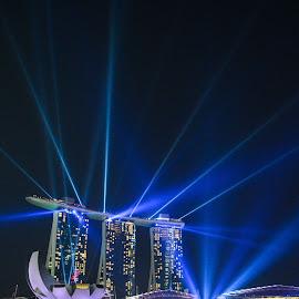 Lighting up the Marina by Kathleen Yap - Buildings & Architecture Public & Historical ( water, reflection, night life, laser show, marina bay sands, marina, singapore, nightscape )