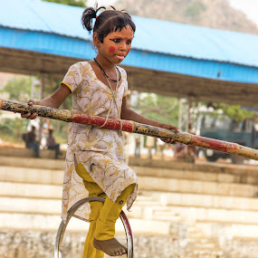 Rope walker by Amit Aggarwal - People Musicians & Entertainers ( girl, rope walking, wheel, pushkar, rajasthan, stadium, india, fair, camel fair 2013 )
