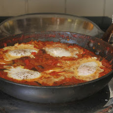 This spicy North African pepper and tomato stew with eggs baked on top makes a lovely, lazy brunch or supper