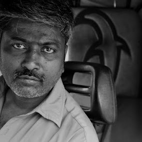 In for a Ride! by Akash Kumar - Novices Only Portraits & People ( black n white, catch light, emotions, driver, rikshaw driver catchlight, portrait )