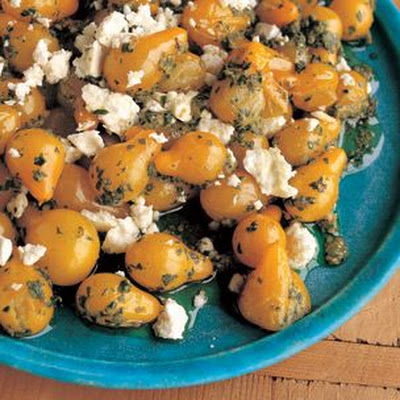 Sautéed Yellow Pear Tomatoes with Arugula Pesto and Feta