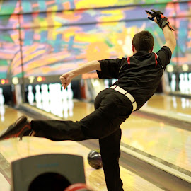 Strike  by Dale Wooten - Sports & Fitness Bowling ( athelete, bowl, high schoo, fun, bowling, boy, bowler, shallow depth of field, athletic )