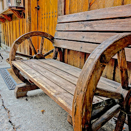 The Wagon Wheel Bench by Barbara Brock - Buildings & Architecture Other Exteriors ( western bench, outdoor bench, wood bench, wagon wheel bench, wooden bench )