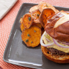 Short Rib Burgers on Pretzel Buns with Hoppy Cheddar Sauce & Roasted Sweet Potato Rounds