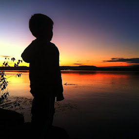 Levi watching the sunset and doing what most boys do on the river bank.. by Berry Fraley - Instagram & Mobile iPhone (  )