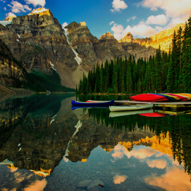 Moraine Lake by Joseph Law - Landscapes Waterscapes ( national park, blue sky, mornoing times, bushes, boats, rocky mountains, trees, reflections, shine upon, rocks, banff, moraine lake )