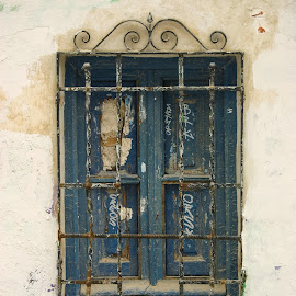 Window, Andalucia, Spain by Steve Griffiths - Buildings & Architecture Other Exteriors ( wood, window, stone, view, iron, wall )