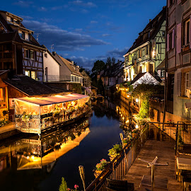 Petite Venise By Night by Lillian Molstad Andresen - City,  Street & Park  Night ( half timbered houses, colmar city, reflections, architecture, landscape, city, lights, sky, nature, watercanal, france, flowers, evening, restaurants, balcony, clouds, water, houses, windows, terrasse, canal, roofs, night, river, colmar,  )