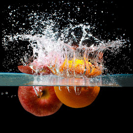 Splash with colors by Nauman Khan - Food & Drink Fruits & Vegetables ( water, orange, fruit, splash, food, apple, vegetables, splash water photography )