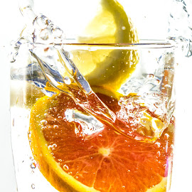 Like Lemons and Oranges by Greg Wytcherley - Food & Drink Fruits & Vegetables ( stop action, water, fruit, beverage, splash, glass, close )