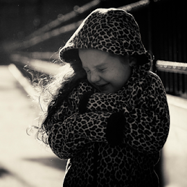 The hint of a smile by Joseph Humphries - Babies & Children Children Candids ( love, sand, blackandwhite, monochrome, windy, leopardprint, daughter, innocence, leadinglines, bridge, smile )