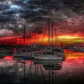 Bleeding  by David Konieczko - Landscapes Sunsets & Sunrises ( clouds, red, lake michigan, sunsets, cloudscape, reflections, boats boating )