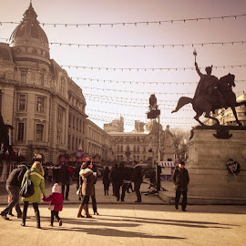 Sunny day in Bucharest by Matei Iulian - City,  Street & Park  Street Scenes ( iphone4s, bucharest, christmas, market, universitysquare, people, children, photography, sky, blue, statues, buildings, history, architecture, shadows, ig_romania, visit_bucharest, visit_romania, vignette, relax )