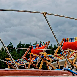 On the Deck by Barbara Brock - Artistic Objects Furniture ( cloudy sky, sunning on the deck, folding chairs, boat furniture, blue, orange. color )