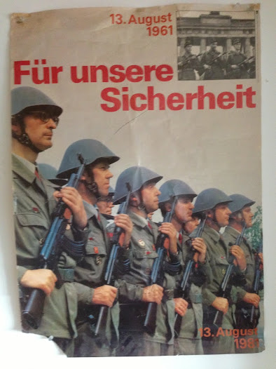 In 1982 East Germany celebrated 20 years of the Berlin Wall with a poster labelled 'For our security' fprominently eaturing a border guard resembling Erich Honecker.