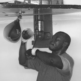 Friday Ahunanya hits the speed bag. by Stephen Jones - Sports & Fitness Boxing