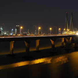 Across the Sea by Ajit Pillai - Buildings & Architecture Bridges & Suspended Structures ( mumbai, sea, night, transportation, bridge, bandra,  )