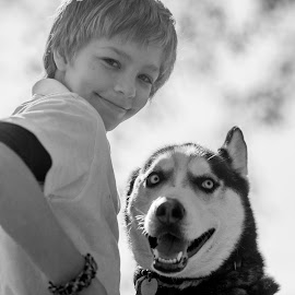 Boy & His Dog by Eva Ryan - Babies & Children Child Portraits ( backlit, black and white, outdoor, smile, dog, boy,  )