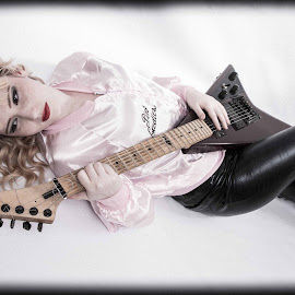 it all about the rock and roll by Laura Scrimshaw - People Musicians & Entertainers ( pvc, lady, guitar, pink, black )