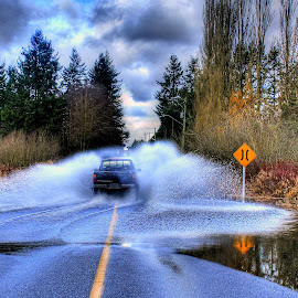 Give It by Ernie Kasper - Transportation Automobiles ( clouds, water, spray, canada, splash, truck, street, reflections, windows, road, sign, bushes, flood, trees, yellow line )