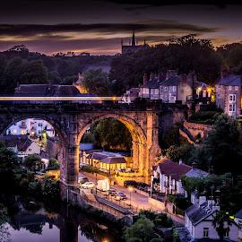 Speeding over the bridge by Donna Brittain - City,  Street & Park  Night ( lights, village, yorkshire, train, night, bridge, cityscape, night sky, city, knaresborough. uk, purple, yellow, color, Urban, City, Lifestyle,  )