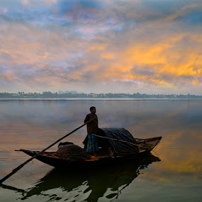 A Golden Dawn by Chiradeep Mukhopadhyay - Landscapes Waterscapes ( ganga, reflection, west bengal, kolkata, ganges, boat, fishing boat, dawn, sky, calcutta, india, sunrise, fisherman, river )