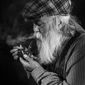Lighting his pipe by Rakesh Syal - People Portraits of Men