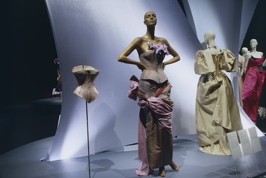 """Especially within the world of fashion, cultural signs, like the corset, have no fixed meaning. Throughout human history, people in all cultures have demonstrated an urge to """"dress"""" or """"fashion"""" their bodies in ways that respond to particular sociocultural ideals of beauty, eroticism, status, conformity, and other powerful forces. As we move through the 21st century, the corset shows no signs of disappearing."""