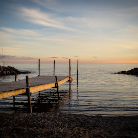 On the Dock by Jennifer Bacon - Landscapes Beaches ( water, winter, sunset, lake, landscape, photography, dock )