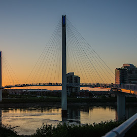 Omaha at sunset by Jonathan Abrams - City,  Street & Park  Skylines ( omaha, skyline, park, sunset, cables, suspension, night, bridge, city, river )