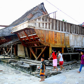 Traditional Village and Houses in Nias by Leong Jeam Wong - Buildings & Architecture Homes ( timber, traditional, attap, house, people, log )