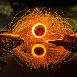 Light trail at fishpond by Andi Appa - Abstract Light Painting
