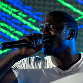 Black singer Akon in front of screen by Nick Dale - People Musicians & Entertainers ( screen, concert, t-shirt, white, singer, turkey, bodrum, stage, black, akon )