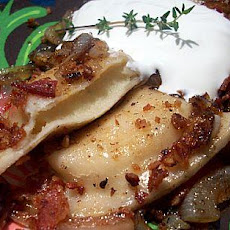 Pierogies With Bacon, Sauteed Onion and Sour Cream