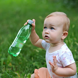 baby ema by Maja Sokolean - Babies & Children Babies ( water, flask, sitting, grass, green, baby girl, baby, bottle,  )