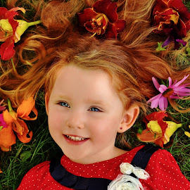 Flowering Hair by Cheryl Korotky - Babies & Children Child Portraits ( vibrant color, flowers in hair, a heartbeat in time photography, amazing faces, blue eyes, beautiful children, child model nevaeh, portrait ideas for children, red head, portrait, red, green,  )
