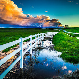 by Becca McKinnon - Landscapes Prairies, Meadows & Fields ( clouds, story, fence, reflection, winding road, california, sunset, redding, millville, millville plains )