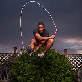 Freeze Jump by Nakean Wickliff - Sports & Fitness Fitness ( flash, wood, location, intense, digital, nakean photography, sky, rope, west seattle, bush, backyard, ropeworks, deck, athlete, black, man, clouds, shallow, high speed test, jumprope, muscle, self portrait, jump, jumper, ripped, nakean wickliff, photos, fence, hypersync, strong, sunset, nakean, shorts, air, high, dof, handsome, strobe )