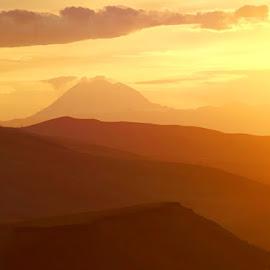 150 miles to Mt Rainier by Gaylord Mink - Landscapes Mountains & Hills ( mountain, mt rainier, distant mountain, sundown, landscape )