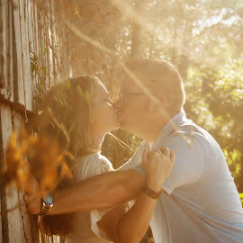 Happy Engagement by Jacenta Grover - People Couples ( kissing, outdoors, almost married, sun flare, engagement )