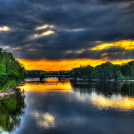 Sunset on the Rock River by John Larson - Landscapes Sunsets & Sunrises ( sunbeams, reflections, forest, bridge, clouds.sunset.trees )