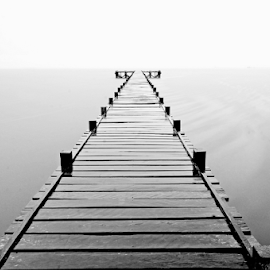 Lampia Jetty in Heavy Rain by Kurniawan Edy Mattalitti - Landscapes Beaches ( slowspeed, bw, landscape )